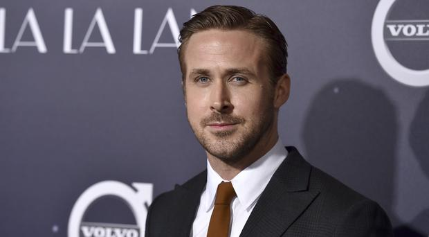 Ryan Gosling arrives at the Los Angeles premiere of La La Land (Invision/AP)