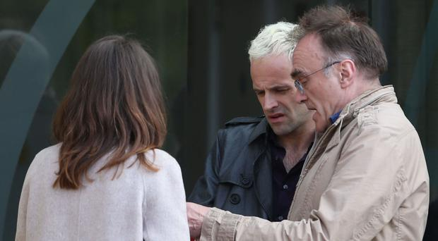 Director Danny Boyle (right) with actor Jonny Lee Miller (centre) during the filming of Trainspotting 2 in Edinburgh