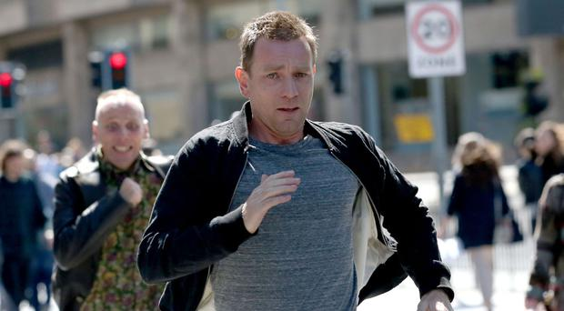 Ewan McGregor and Ewen Bremner running through the streets of Edinburgh during the filming of Trainspotting 2