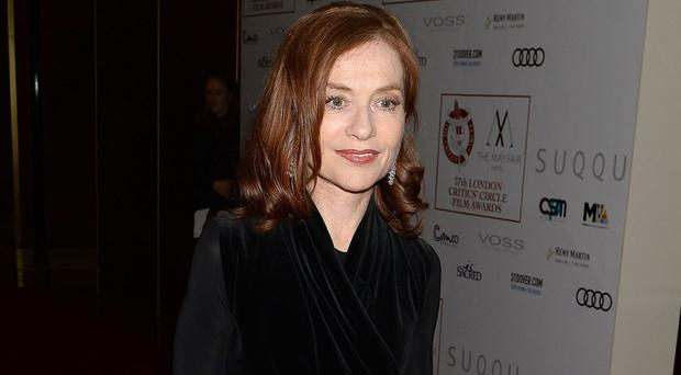 Isabelle Huppert arriving at the Critics' Circle Film Awards in London - she left with the actress of the year prize
