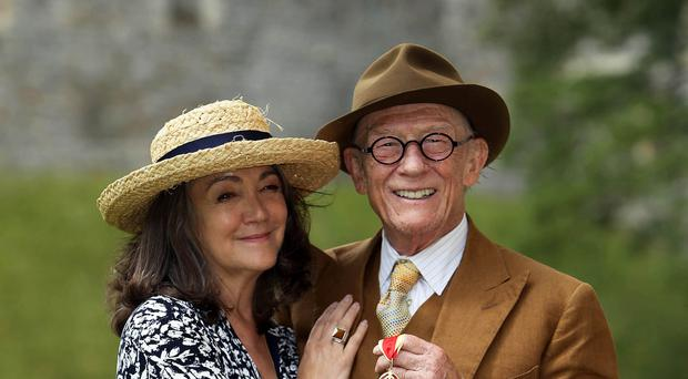 Sir John Hurt, who has died from cancer aged 77, with his wife Anwen.