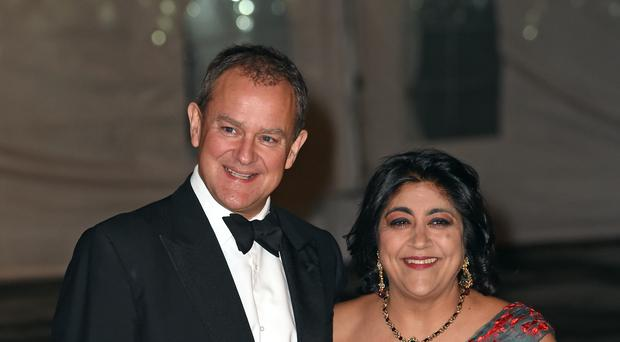 Hugh Bonneville and Gurinder Chadha arrive at the dinner