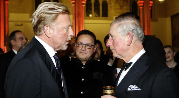 The Prince of Wales (right) speaks with Boris Becker during a reception and dinner for supporters of the British Asian Trust at Guildhall, London.