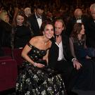 The Duke and Duchess of Cambridge take their seats as they attend the EE British Academy Film Awards held at the Royal Albert Hall, Kensington Gore, Kensington, London.