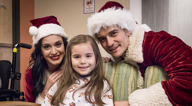 Katy Perry and Orlando Bloom visiting the Children's Hospital of Los Angeles during the festive period