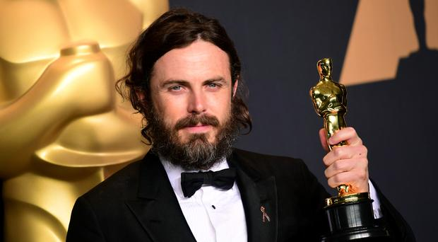 Casey Affleck with his best actor Oscar