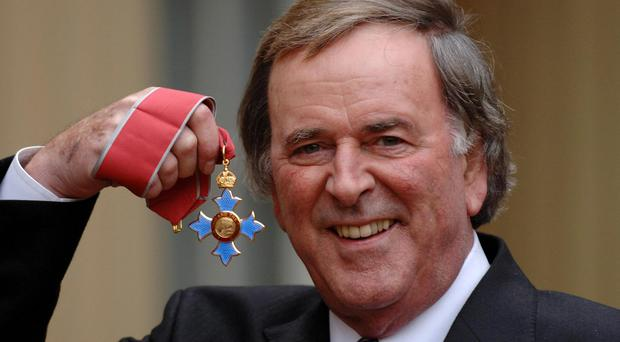 Broadcaster Sir Terry Wogan, 67 after the radio and television presenter collected his knighthood from Britain's Queen Elizabeth II during an investiture ceremony at Buckingham Palace London, Tuesday December 6, 2005. See PA story ROYAL Investiture. PRESS ASSOCIATION Photo. Photo credit should read: Fiona Hanson/Rota/PA