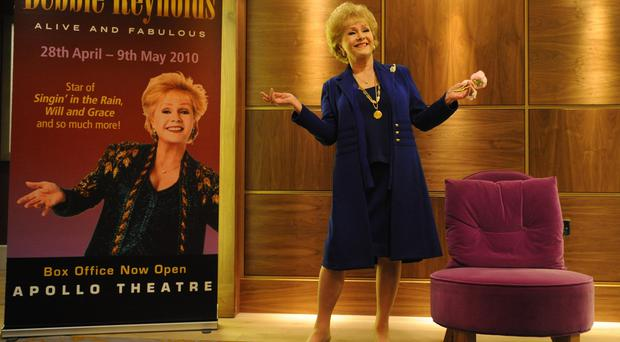 File photo dated 1/4/2010 of Hollywood actress Debbie Reynolds, who has died barely a day after the death of her daughter Carrie Fisher, posing for pictures in London as she celebrated her 78th birthday and announced her first UK tour.