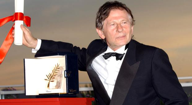 Film Director Roman Polanski with the Palme d'Or he received for his film 'The Pianist' at the Palais des Festival, at the 55th Cannes Film Festival.