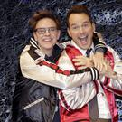 Director James Gunn, left, laughs with American actor Chris Pratt during a media conference of