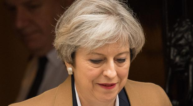 Prime Minister Theresa May leaves 10 Downing Street, London, ahead of Prime Minister's Questions.