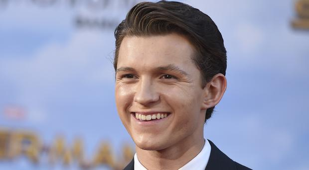Tom Holland takes the lead in his first Spider-Man film (Jordan Strauss/AP)