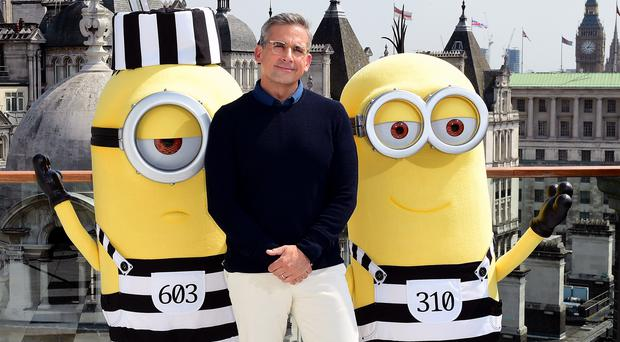 Steve Carell with two Minions (Ian West/PA)