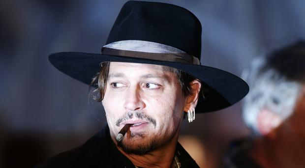 Johnny Depp is in a multi-million legal battle with his former managers (Yui Mok/PA)