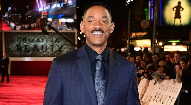 Will Smith is to voice the Genie in Aladdin (Ian West/PA)