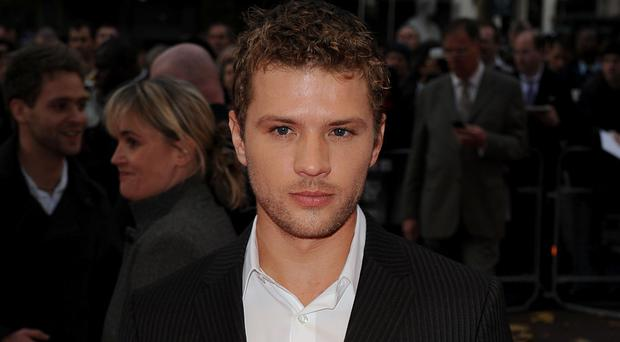 Ryan Phillippe broke his leg in 'freak accident' on family outing (Ian West/PA)