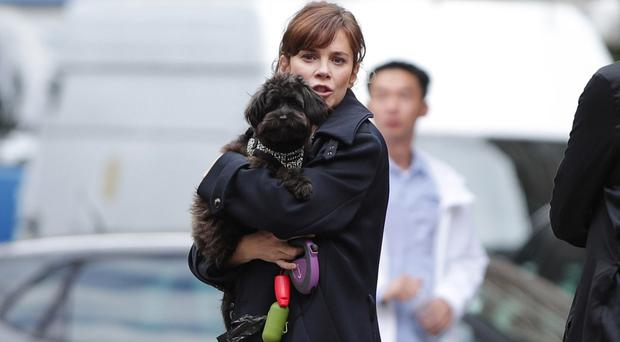 Anna Friel enjoyed some play time with her dog (Yui Mok/PA)
