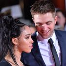 Robert Pattinson and FKA Twigs attend a premiere (Matt Crossick/PA)