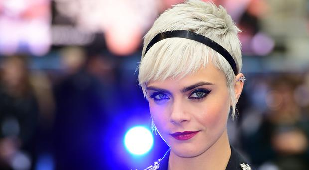 Cara Delevingne has debuted her music video (Ian West/PA)