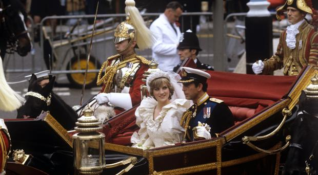 The Prince and Princess of Wales in a carriage after their wedding at St Paul's Cathedral (PA)