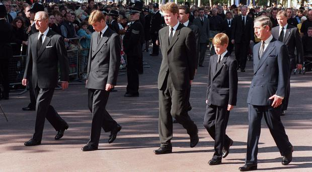 File photo dated 06/09/1997 of (left to right) The Duke of Edinburgh, Prince William, Earl Spencer, Prince Harry and the Prince of Wales walking behind the coffin of Diana, Princess of Wales during her funeral procession to Westminster Abbey (Tony Harris/PA Wire)