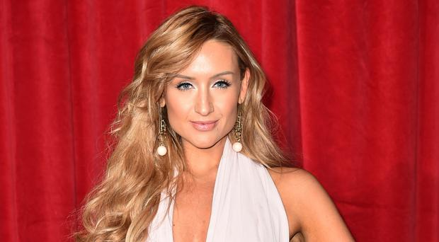 Catherine Tyldesley's character gets dressed up to help out in the grotto (Matt Crossick/PA)