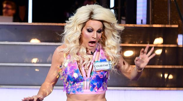 CBB's Courtney Act had a wardrobe malfunction as she entered the house (Ian West/PA)