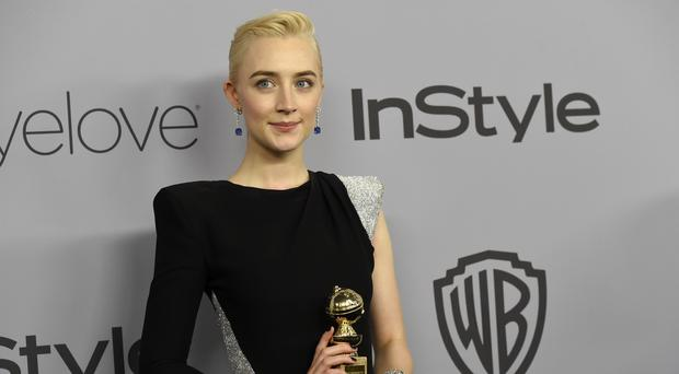 Saoirse Ronan receives a Golden Globe for best actress (Chris Pizzello/Invision/AP)