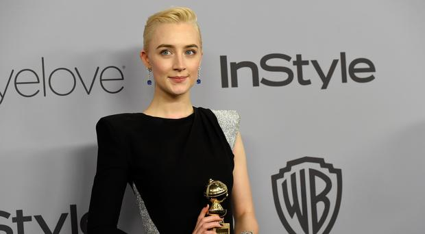Saoirse Ronan received a Golden Globe for best actress on Sunday (Chris Pizzello/Invision/AP)