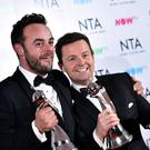 Ant and Dec with their three trophies (Ian West/PA)
