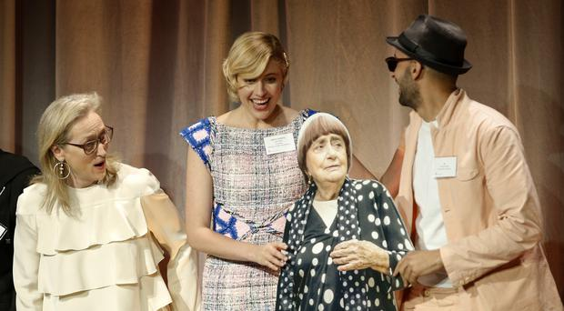Meryl Streep, from left, and Greta Gerwig react as JR, right, holds a cardboard cut-out of Agnes Varda at the 90th Academy Awards nominees luncheon (Danny Moloshok/Invision/AP)