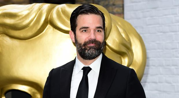 Rob Delaney shared the heartbreaking news (Ian West/PA)