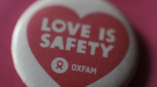 An Oxfam badge with the message 'Love is Safety', as Penny Mordaunt said the charity had failed to show 'moral leadership' (PA)