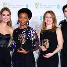 Lily James (left) and Gemma Arterton (right) with Rungano Nyoni (second left) and Emily Morgan (second right) and their Bafta for outstanding debut by a British Writer, Director or Producer in the press room Kensington, London. (Ian West/PA)