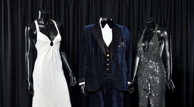 Lawrence and Bale's American Hustle costumes with Amy Adams's (l-r)