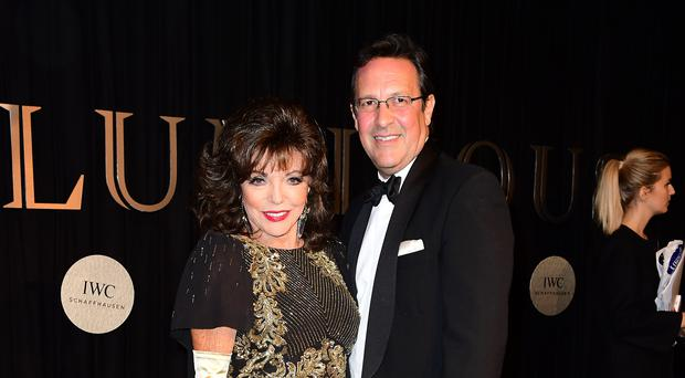Dame Joan Collins and Percy Gibson (Ian West/PA)