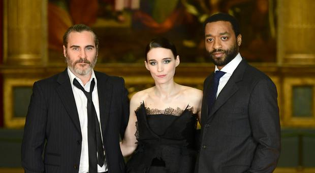JJoaquin Phoenix, Rooney Mara and Chiwetel Ejiofor at the premiere of Mary Magdalene (Ian West/PA)