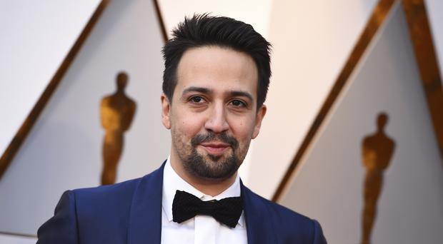Lin-Manuel Miranda arrives at the Oscars (Jordan Strauss/Invision/AP)