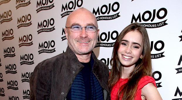 Phil Collins and daughter Lily (Ian West/PA)