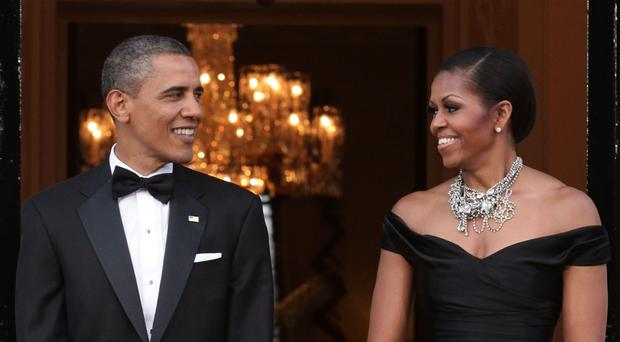 Barack and Michelle Obama are in advanced negotiations with Netflix to produce a series, it has been reported (PA)