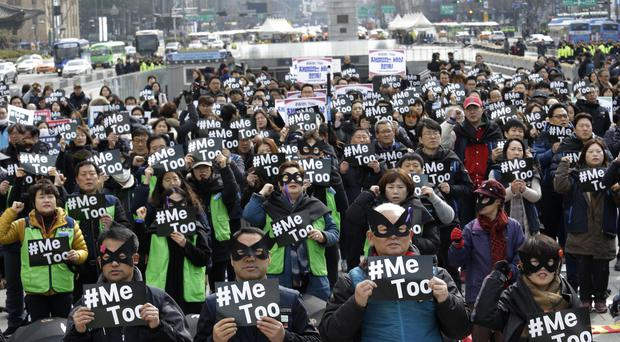 Demonstrators supporting the MeToo movement in South Korea on International Women's Day (Ahn Young-joon/AP)