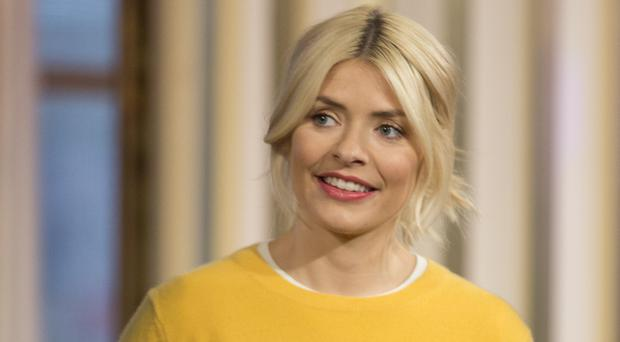 Holly Willoughby battled an awkward coughing fit during her TV interview (Isabel Infantes/PA)