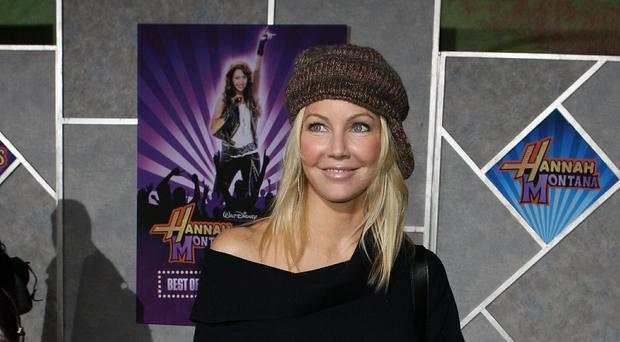 Heather Locklear has been charged