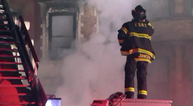 New York firefighters at the scene of the blaze (WPIX-11 via AP)