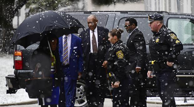 Bill Cosby, centre, arrives for jury selection (Correy Perrine/AP)