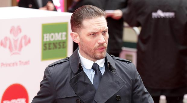 Tom Hardy stars as journalist Eddie Brock, who becomes Venom (Yui Mok/PA)