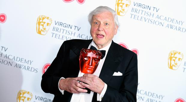 Sir David Attenborough with the award for Virgin TV's Must-see moment in the press room at the Virgin TV British Academy Television Awards 2018 (Ian West/PA)