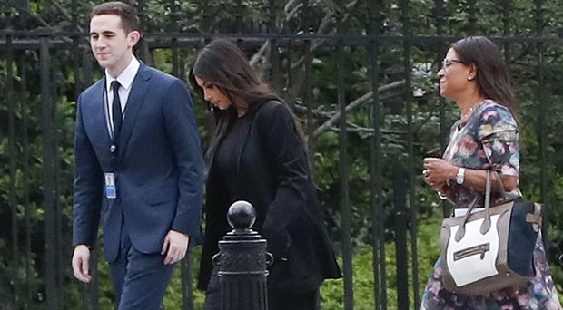 Kim Kardashian, center, arrives with her attorney Shawn Chapman Holley at the White House (Pablo Martinez Monsivais/AP)