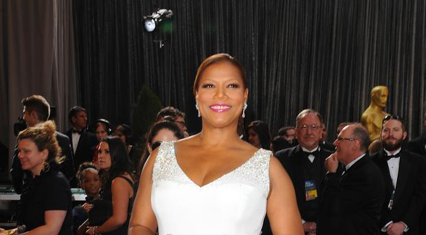 Queen Latifah has thanked a woman for comforting her about her mother's death. (Ian West/PA)