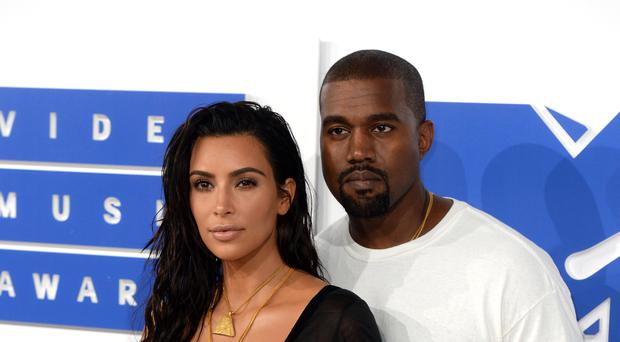 Kim Kardashian has given Kanye West a musical Rick and Morty birthday card (PA)